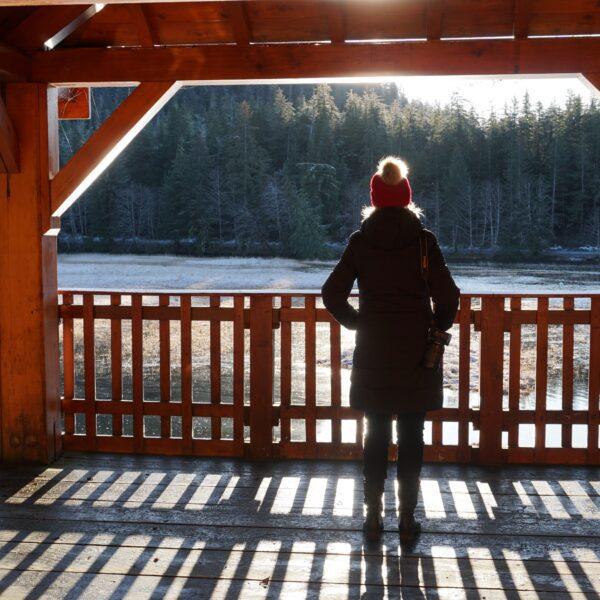 A visitor overlooking Starrigavan Estuary in winter