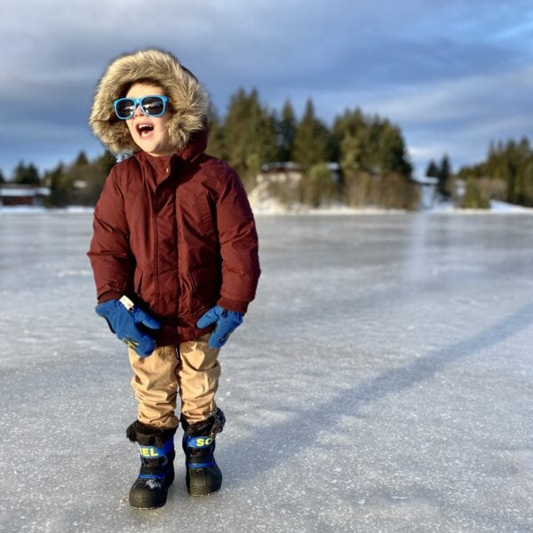 A child plays on frozen Swan Lake